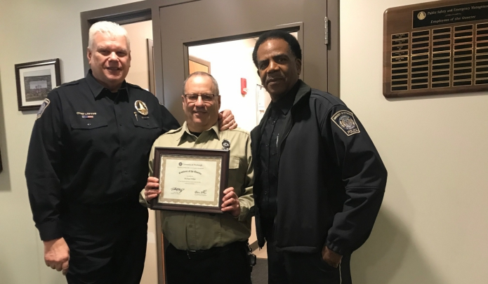 Employee of the Quarter - Michael Arkin with Chief Loftus and Commander Ellies