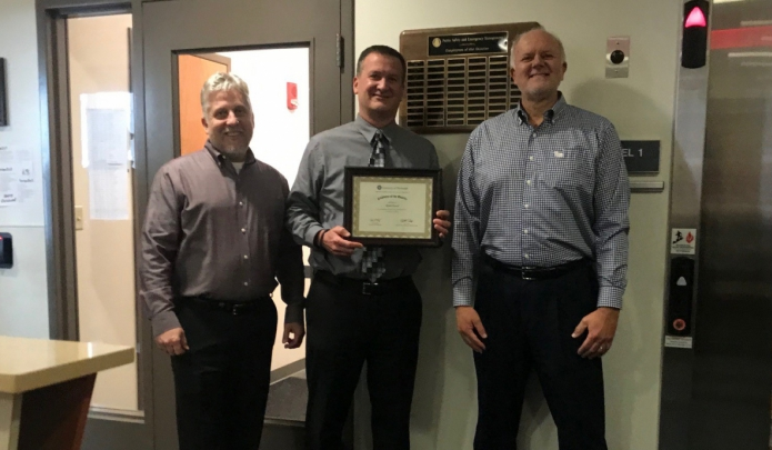 Employee of the Quarter- Keith Duval with Director of Environmental Health and Safety, Jay Frerotte and Associate Vice Chancellor, Ted Fritz