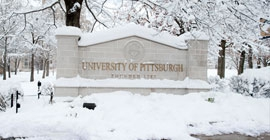 Pitt sign covered in snow